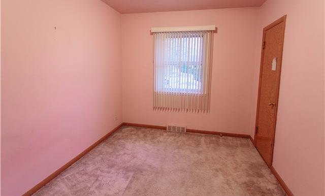 Bedroom. The third bedroom.  Hardwood under the carpet