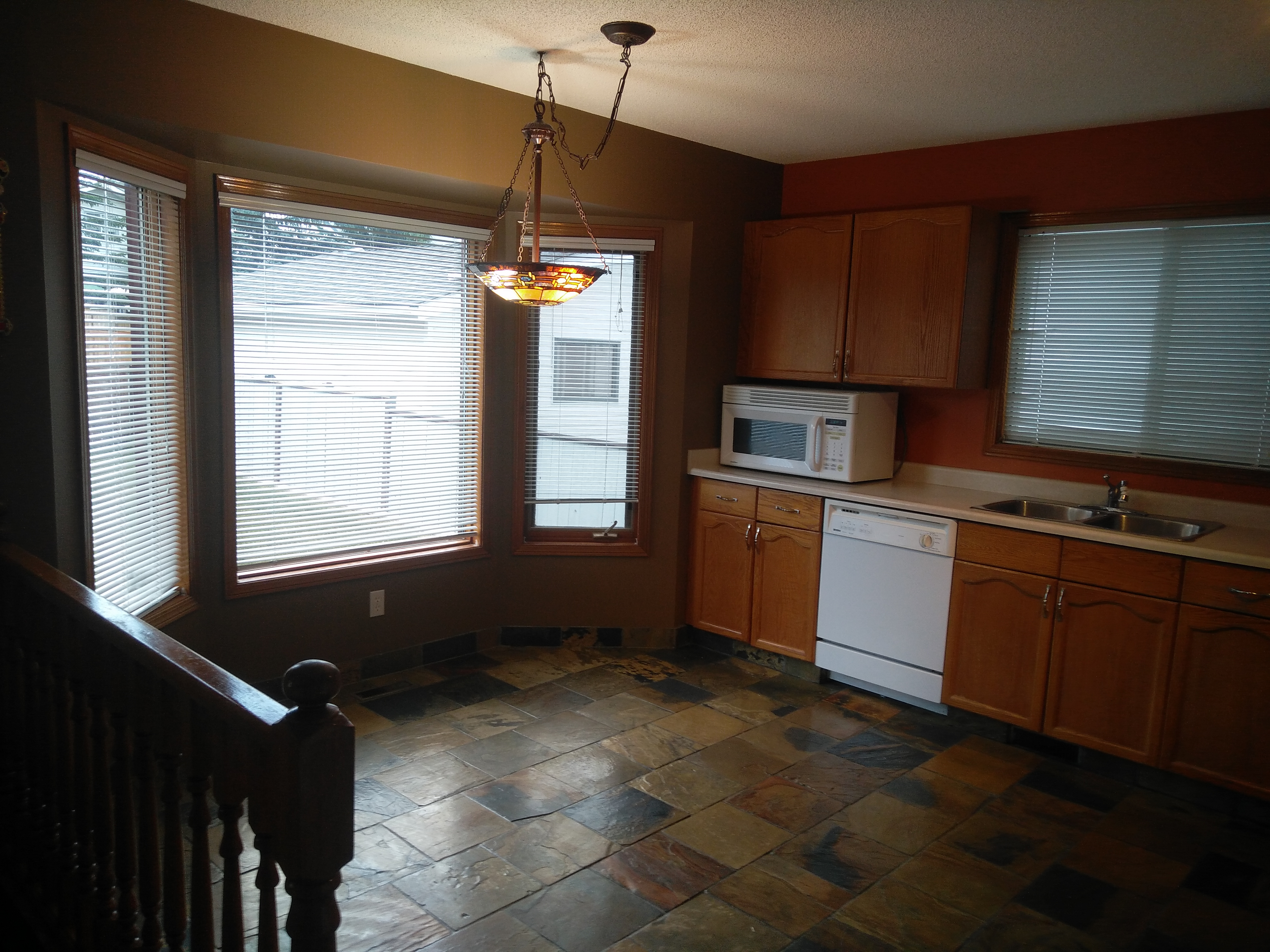 Over 2600 sqft of total living space, double garage home in Millrise!